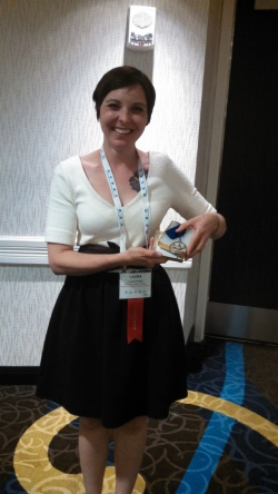 Laura poses with her ICCTA 2014 Faculty of the Year medal