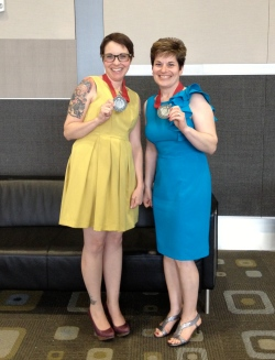Laura Power and Julie Freelove show off their NISOD 2013 Excellence in Teaching medals